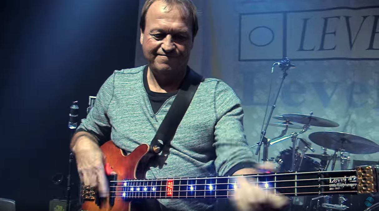 """Mark King, the guy who """"slaps the shit out of"""" his bass. Picture source: Youtube."""