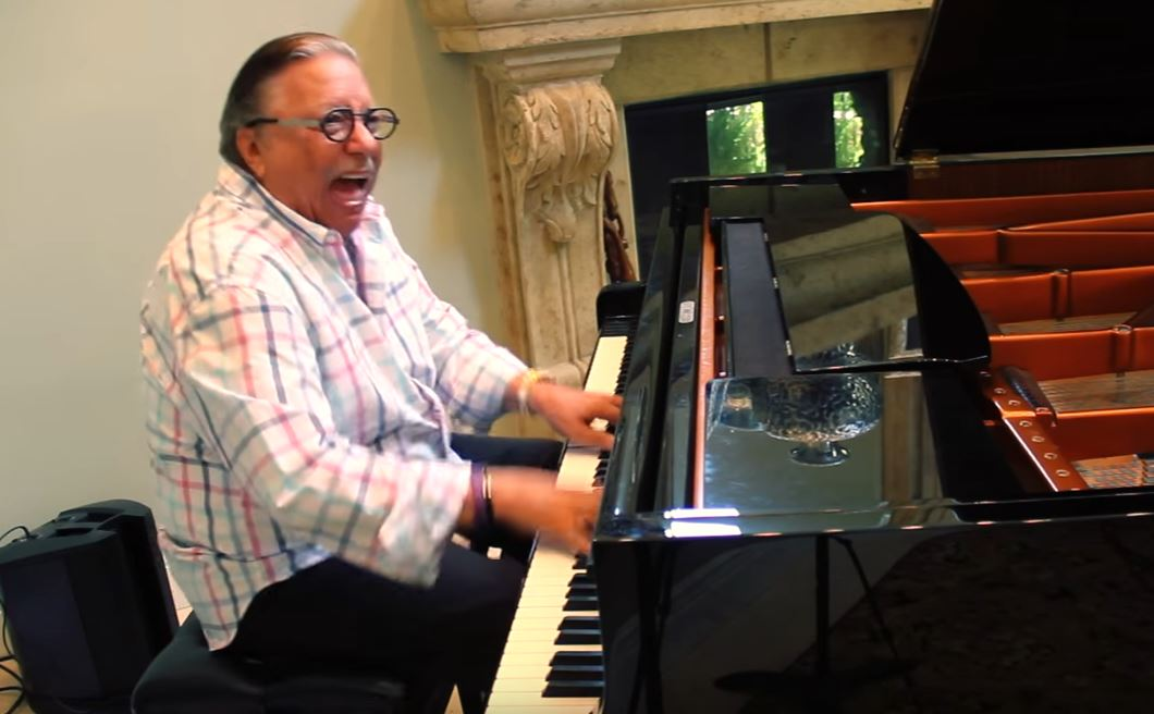 Trumpet hero Arturo Sandoval, working on the concert grand.